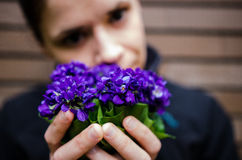 Woman with violet flowers stock image