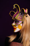 Woman in violet half mask Royalty Free Stock Image