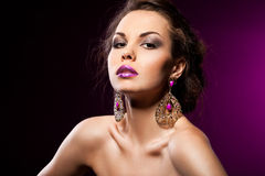 Woman with violet jewelry Stock Photos