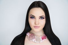 Woman violet make up long black hair royalty free stock image