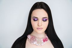 Woman violet make up long black hair royalty free stock images
