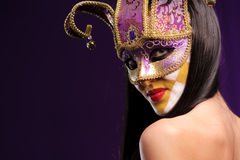 Woman in violet mask Royalty Free Stock Photo