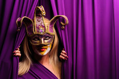 Woman in violet mask Royalty Free Stock Image