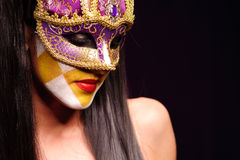 Woman in violet mask Royalty Free Stock Photography