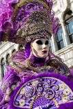 Woman in violet mask at The Carnival of Venice 2018 royalty free stock image