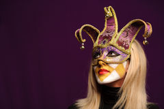 Woman in violet party mask Stock Image
