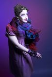 Woman in violet. Portrait of young woman in violet shawl and with face-art Royalty Free Stock Image