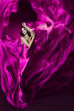 Woman in violet waving silk dress as flame