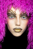 Woman in violet wig Stock Images