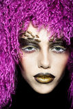 Woman in violet wig Stock Image