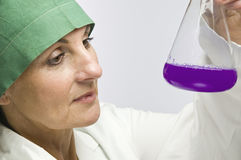 Woman with violett fluid Royalty Free Stock Image
