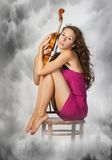 Woman and violin. Pretty young woman  holding viola in her hands Stock Photography
