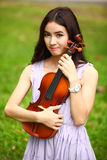 Woman and violin Stock Photo