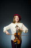 The woman violin player in musical concept. Woman violin player in musical concept Stock Photo