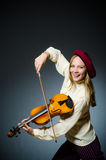 The woman violin player in musical concept. Woman violin player in musical concept Royalty Free Stock Photo
