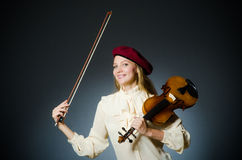 The woman violin player in musical concept. Woman violin player in musical concept Royalty Free Stock Photography