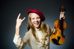 The woman violin player in musical concept. Woman violin player in musical concept Royalty Free Stock Image