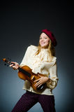 The woman violin player in musical concept Stock Images