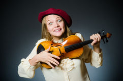The woman violin player in musical concept Royalty Free Stock Image