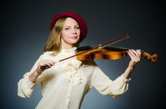 The woman violin player in musical concept Stock Photography