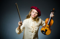 The woman violin player in musical concept. Woman violin player in musical concept Royalty Free Stock Images