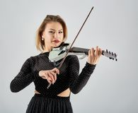 Violin player lady. Woman violin player, studio shot Stock Image