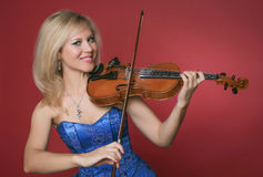 Woman violinist in blue dress Stock Image