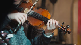 Woman violinist - musician playing the violin in night club. Close up Royalty Free Stock Photo