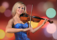 Woman the violinist plays violin Royalty Free Stock Images