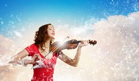 Woman violinist Royalty Free Stock Image