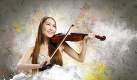 Woman violinist Royalty Free Stock Images