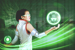 Woman with virtual button and earth graphic. Picture of a futuristic woman holding a virtual button and earth graphic on her hands Royalty Free Stock Images