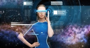 Woman in virtual reality 3d glasses with charts Royalty Free Stock Image