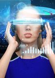 Woman in virtual reality 3d glasses with charts Stock Image