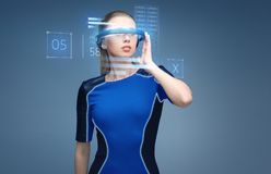Woman in virtual reality 3d glasses with charts Stock Images