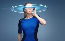 Woman in virtual reality 3d glasses with hologram Royalty Free Stock Photos