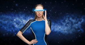 Woman in virtual reality 3d glasses over black Stock Photography