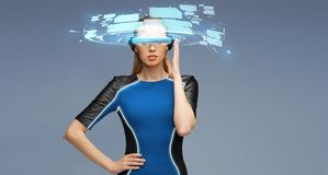 Woman in virtual reality 3d glasses with screens Stock Photography