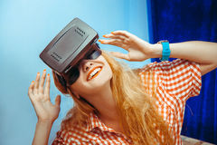 Woman in virtual reality glasses. Close up portrait of Cheerful beauty girl in virtual reality helmet. VR glasses. Virtual reality. Third dimension royalty free stock photo