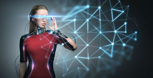 Woman in virtual reality glasses and microchip Stock Image