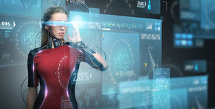 Woman in virtual reality glasses and microchip Stock Photos