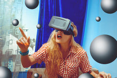Woman in virtual reality glasses. Surprised young caucasian woman in virtual reality helmet. VR glasses. Virtual reality. Third dimension stock images