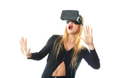 Woman in virtual reality glasses. Surprised young girl in virtual reality glasses isolated on white background. VR helmet. third dimension. Virtual reality royalty free stock photo