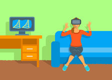 Woman in virtual reality glasses VR box at home Stock Image