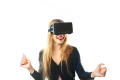 Woman in virtual reality glasses. Young happy woman in virtual reality helmet isolated on white background. VR glasses. Third dimension. Virtual reality helmet royalty free stock photography