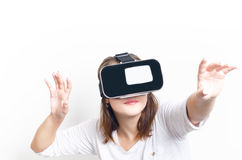 Woman with virtual reality goggles. Isolated. White background. Studio Woman show a gesture. Woman with virtual reality goggles. Isolated. White background stock photos