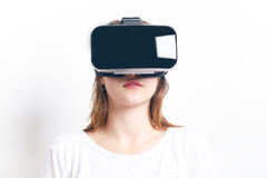 Woman with virtual reality goggles. Isolated. White background. Studio Woman show a gesture. Woman with virtual reality goggles. Isolated. White background stock photography