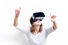 Woman with virtual reality goggles. Isolated. White background. Studio Woman show a gesture. Woman with virtual reality goggles. Isolated. White background stock images