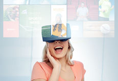 Woman in virtual reality headset or 3d glasses Stock Photo