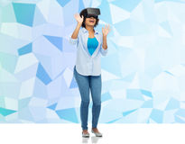 Woman in virtual reality headset or 3d glasses Stock Photography
